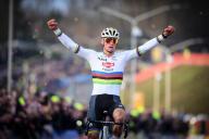 Dutch Mathieu Van Der Poel celebrates as he crosses the finish line to win the men
