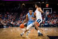 December 8, 2019: North Carolina Guard Christian Keeling (55) and Virginia Guard Tomas Woldetensae (53) during the NCAA Basketball game between the University of North Carolina Tar Heels and University of Virginia Cavaliers at John Paul Jones Arena in Charlottesville, VA. Brian McWalters/