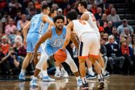 December 8, 2019: North Carolina Guard Jeremiah Francis (13) defends Virginia Guard Kihei Clark (0) during the NCAA Basketball game between the University of North Carolina Tar Heels and University of Virginia Cavaliers at John Paul Jones Arena in Charlottesville, VA. Brian McWalters/