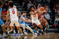 December 8, 2019: Virginia Guard Tomas Woldetensae (53) during the NCAA Basketball game between the University of North Carolina Tar Heels and University of Virginia Cavaliers at John Paul Jones Arena in Charlottesville, VA. Brian McWalters/