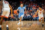December 8, 2019: North Carolina PLAYER (99) and Virginia PLAYER (99) during the NCAA Basketball game between the University of North Carolina Tar Heels and University of Virginia Cavaliers at John Paul Jones Arena in Charlottesville, VA. Brian McWalters/