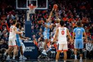 December 8, 2019: North Carolina Forward Garrison Brooks (15) blocks Virginia Forward Mamadi Diakite (25) during the NCAA Basketball game between the University of North Carolina Tar Heels and University of Virginia Cavaliers at John Paul Jones Arena in Charlottesville, VA. Brian McWalters/