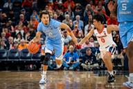 December 8, 2019: North Carolina Guard Cole Anthony (2) and Virginia Guard Kihei Clark (0) during the NCAA Basketball game between the University of North Carolina Tar Heels and University of Virginia Cavaliers at John Paul Jones Arena in Charlottesville, VA. Brian McWalters/