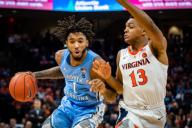 December 8, 2019: North Carolina Guard Leaky Black (1) is defended by Virginia Guard Casey Morsell (13) during the NCAA Basketball game between the University of North Carolina Tar Heels and University of Virginia Cavaliers at John Paul Jones Arena in Charlottesville, VA. Brian McWalters/