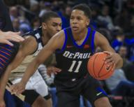 Saturday Jan 18 - DePaul Blue Demons guard Charlie Moore (11) drives to the basket during the NCAA game between the Butler Bulldogs and the DePaul University Blue Demons at Wintrust Arena in Chicago IL. Gary E. Duncan Sr/
