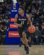 Saturday Jan 18 - DePaul Blue Demons guard Charlie Moore (11) drives the ball down court during the NCAA game between the Butler Bulldogs and the DePaul University Blue Demons at Wintrust Arena in Chicago IL. Gary E. Duncan Sr/