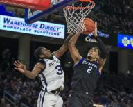 Saturday Jan 18 - DePaul Blue Demons forward Jaylen Butz (2) is fouled by Butler Bulldogs guard Kamar Baldwin (3)during the NCAA game between the Butler Bulldogs and the DePaul University Blue Demons at Wintrust Arena in Chicago IL. Gary E. Duncan Sr/