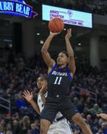 Saturday Jan 18 - DePaul Blue Demons guard Charlie Moore (11) puts up a shot during the NCAA game between the Butler Bulldogs and the DePaul University Blue Demons at Wintrust Arena in Chicago IL. Gary E. Duncan Sr/