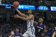 Saturday Jan 18 - Butler Bulldogs guard Aaron Thompson (2) drives past the defense of DePaul Blue Demons forward Paul Reed (4) on the way to the basket during the NCAA game between the Butler Bulldogs and the DePaul University Blue Demons at Wintrust Arena in Chicago IL. Gary E. Duncan Sr/