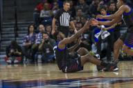 Saturday Jan 18 - DePaul Blue Demons guard Jalen Coleman-Lands (5) is helped up after being fouled on a jump shot during the NCAA game between the Butler Bulldogs and the DePaul University Blue Demons at Wintrust Arena in Chicago IL. Gary E. Duncan Sr/