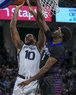 Saturday Jan 18 - Butler Bulldogs forward Bryce Nze (10) puts up a shot contested by DePaul Blue Demons forward Romeo Weems (1) during the NCAA game between the Butler Bulldogs and the DePaul University Blue Demons at Wintrust Arena in Chicago IL. Gary E. Duncan Sr/
