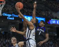 Saturday Jan 18 - Butler Bulldogs guard Aaron Thompson (2) puts up a shot contested by DePaul Blue Demons forward Romeo Weems (1) during the NCAA game between the Butler Bulldogs and the DePaul University Blue Demons at Wintrust Arena in Chicago IL. Gary E. Duncan Sr/
