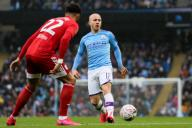 January 26, 2020, Manchester, United Kingdom: Angelino (r) of Manchester City runs at Cyrus Christie of Fulham during the FA Cup match at the Etihad Stadium, Manchester. Picture date: 26th January 2020. Picture credit should read: James Wilson/