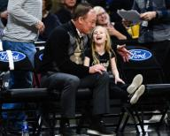 January 25, 2020: Colorado AD Rick George shows his granddaughter the home team bench before receiving an award at halftime of the menââ¬â¢s basketball game between Colorado and Washington at the Coors Events Center in Boulder, CO. Colorado won 76-62. Derek Regensburger/CSM.