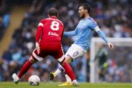 January 26, 2020, Manchester, United Kingdom: David Silva (r) of Manchester City passes the ball away from Stefan Johansen of Fulham during the FA Cup match at the Etihad Stadium, Manchester. Picture date: 26th January 2020. Picture credit should read: James Wilson/
