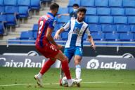 Jonathan Calleri of RCD Espanyol in action with Esteban Burgos of SD Eibar during the Liga match between RCD Espanyol and SD Eibar at RCD Stadium on July 12, 2020 in Barcelona, Spain. (Photo by DAX\/ESPA-Images