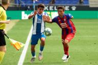 Victor Gomez of RCD Espanyol in action with Takashi Inui of SD Eibar during the Liga match between RCD Espanyol and SD Eibar at RCD Stadium on July 12, 2020 in Barcelona, Spain. (Photo by DAX\/ESPA-Images