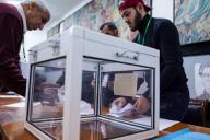 12 December 2019, Algeria, Algiers: Election workers count ballot papers following the presidential election at a polling station. Photo: Farouk Batiche/