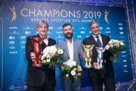 """14 December 2019, Berlin: Hagen Stamm (l-r), national water polo coach, Christian Arbeit, press spokesman FC Union Berlin and Kaweh Niroomand, Berlin Volleys Manager, hold the trophies at the Berlin Athlete of the Year Gala. Stamm took third place, Arbeit accepted first prize on behalf of Urs Fischer, and Niroomand second prize for Cedric Enard in the """"Manager/Trainer"""" category. The Audience Prize has been awarded since 1979. Photo: Jörg Carstensen/"""