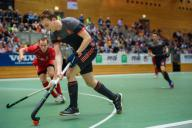 17 January 2020, Berlin: Hockey, Men: European Championship, Belgium - Netherlands, preliminary round, Group B, 2nd matchday. The Dutchman Max Sweering sprints along the sideline past Belgian national players. Photo: Gregor Fischer/