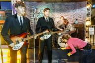 26 January 2020, Hamburg: Two employees of Panoptikum clean the dolls of the Beatles in the re-enacted Starclub. Once a year the figures of the Panoptikum, as well as their clothes and hair, are cleaned and repaired. Photo: Markus Scholz/