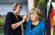 26 January 2020, Hamburg: Make-up artist Henriette Masmeier nails the wig on the wax head of the doll of Chancellor Angela Merkel after it has been washed. Once a year the figures of the Panoptikum, as well as their clothes and hair, are cleaned and repaired. Photo: Markus Scholz/