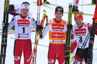 26 January 2020, Bavaria, Oberstdorf: Nordic combined: World Cup, Jens Luraas Oftebro (l-r) from Norway (second), Jarl Magnus Riiber from Norway (first) and Franz-Josef Rehrl from Austria (third) cheer at the finish. Photo: Karl-Josef Hildenbrand/