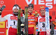 26 January 2020, Bavaria, Oberstdorf: Nordic combined: World Cup, Jens Luraas Oftebro (l-r) from Norway (second), Jarl Magnus Riiber from Norway (first) and Franz-Josef Rehrl from Austria (third) cheer on the podium. Photo: Karl-Josef Hildenbrand/