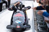 26 January 2020, Bavaria, Schönau Am Königssee: Four-man bobsleigh, gentlemen, artificially-iced track at Königssee, second heat. Justin Kripps, Ryan Sommer, Benjamin Coakwell and Cameron Stones from Canada cheered at the finish. The bob took third place. Photo: Sven Hoppe/