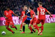21 February 2020, Bavaria, Munich: Football: Bundesliga, Bayern Munich - SC Paderborn 07, 23rd matchday in the Allianz Arena. David Alaba (l), Alvaro Odriozola (2nd from right) and Joshua Kimmich (r) from FC Bayern Munich Bayern Munich and Dennis Srbeny (2nd from left) from Paderborn fight for the ball. Photo: Peter Kneffel/dpa - IMPORTANT NOTE: In accordance with the regulations of the DFL Deutsche Fußball Liga and the DFB Deutscher Fußball-Bund, it is prohibited to exploit or have exploited in the stadium and/or from the game taken photographs in the form of sequence images and/or video-like photo series.