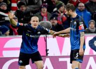 21 February 2020, Bavaria, Munich: Football: Bundesliga, Bayern Munich - SC Paderborn 07, 23rd matchday in the Allianz Arena. Sven Michel (l) and Christian Strohdiekvom SC Paderborn 07 cheer after Michel
