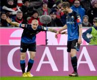 21 February 2020, Bavaria, Munich: Football: Bundesliga, Bayern Munich - SC Paderborn 07, 23rd matchday in the Allianz Arena. Sven Michel (l) and Christian Strohdiek from SC Paderborn 07 cheer after Michel