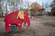 31 March 2020, Lower Saxony, Laatzen: Barrier tape blocks a playground in the Hannover region. Due to the Corona pandemic, playgrounds are currently closed. Photo: Julian Stratenschulte/
