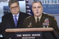 United States Army General Mark A. Milley, Chairman of the Joint Chiefs of Staff speaks during a press conference in the Brady Press Briefing Room of the White House on April 1, 2020 in Washington, DC. Looking on at left is US Attorney General William P. Barr. Credit: Oliver Contreras / Pool via CNP | usage
