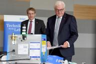 09 July 2020, Schleswig-Holstein, Lübeck: Federal President Frank-Walter Steinmeier (r) visits the plant of medical technology manufacturer Dräger and Daniel Günther (CDU), Prime Minister of Schleswig-Holstein, together with a pandemic ventilator. According to the Office of the Federal President, the visit is the first time the Federal President has visited the plant outside of Berlin since the beginning of the corona crisis. Photo: Carsten Rehder