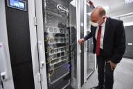 09 July 2020, Thuringia, Jena: Wolfgang Tiefensee (SPD), Minister of Economics of Thuringia, looks at a new high-performance computer at the DLR Institute of Data Sciences, which is officially put into operation on the same day. The institute was founded in 2017 by the German Aerospace Center (DLR) in Jena. Its task is to analyse large amounts of data. Photo: Martin Schutt\/dpa-Zentralbild