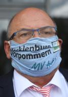 16 July 2020, Mecklenburg-Western Pomerania, Torgelow: Harry Glawe (CDU), the Minister of Economic Affairs, Tourism and Health of Mecklenburg-Western Pomerania, stands with a face mask on the premises of the iron foundry Torgelow (EGT) GmbH. The traditional foundry, which is known above all for its components weighing several tons for large wind turbines and diesel engine construction, is threatened with insolvency. The foundry has around 320 employees and is regarded as one of the structure-determining companies for Vorpommern. Photo: Stefan Sauer\/dpa-Zentralbild