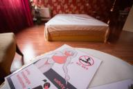 """16 July 2020, Baden-Wuerttemberg, Karlsruhe: A flyer with the inscription """"No Sex, only massage welcome, safety first"""" lies on a table in a study of the brothel """"Lauras Girls"""". Prostitution facilities have also had to be closed in Baden-Württemberg since mid-March as """"particularly infectious facilities"""". With an """"open day"""" several brothels are campaigning for their reopening in the Corona crisis. Photo: Tom Weller"""