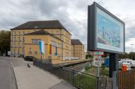24 September 2020, Bavaria, Augsburg: An advertising poster in front of the new branch of the Bavarian Ministry of Construction and Transport points out the new location. The ministry opened another office in Augsburg. Photo: Stefan Puchner\/dpa