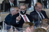 23 September 2020, Schleswig-Holstein, Kiel: Hans-Jörn Arp (CDU) wears a nose-mouthpiece with the logo of the Wacken Open Air during a state parliament session. On Wednesday, the parliament discussed the sports facility development plan, the medium-term finances of the country in the Corona crisis and the reception of refugees from Lesbos. Photo: Frank Molter\/dpa