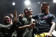 The Colombian singer Maluma (C) sings with youth people of his foundation during a musical festival of his foundation