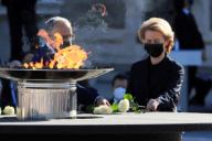 European Comission\'s President, Ursula von der Leyen (R), lays flowers on a bowl containing a torch to mark coronavirus victims at the Royal Palace\'s courtyard during the state tribute to COVID-19 victims and people working on the front line to fight the pandemic in Madrid, Spain, 16 July 2020. The ceremony is chaired by Spain\'s King Felipe VI. EFE\/Fernando Alvarado POOL