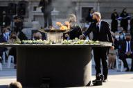 Catalan regional President, Quim Torra (R), lays a white rose on a bowl containing a torch to mark coronavirus victims at the Royal Palace\'s courtyard during the state tribute to COVID-19 victims and people working on the front line to fight the pandemic in Madrid, Spain, 16 July 2020. The ceremony is chaired by Spain\'s King Felipe VI. EFE\/Fernando Alvarado POOL