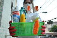 MEXICO CITY, MEXICO - MARCH 30: A woman disinfects surfaces with cleaning products such as chlorine wears gloves and protective mask, health guidelines recommended to avoid contagion of coronavirus outbreak on March 30, 2020 in Mexico City, Mexico