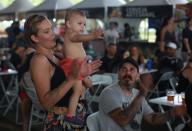 CAMPINAS, SP - 14.12.2019: CENA DO DIA - Mother enjoys with her son a rock concert in Campinas (SP). (Photo: Leandro Ferreira/Fotoarena)