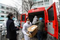 People move medical supply off a JD.com van coming from the coastal Jiangsu province at a hospital in Wuhan in central China