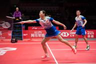 Chinese professional badminton players Zheng Siwei and Huang Yaqiong compete against Japanese professional badminton players Yuta Watanabe and Arisa Higashino at the group stage of mixed doubles at HSBC BWF World Tour Finals, Guangzhou city, east China