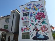Farmers have their wall painted with rural and local elements, which spent them over 10000 Yuan (1400 USD), to decorate the house, Xujiachong village, Taipingxi town, Yiling district, Yichang city, central China\'s Hubei province, 30 May 2020. Local Caption