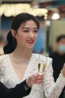 Chinese actress and singer Wan Qian shows up in white dress, showing off beauty at a promotional event, Shanghai, China, 24 September 2020