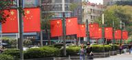 National flags of China are hung in the street light, welcoming the upcoming National Day, Nanjing city, east China\'s Jiangsu province, 24 September 2020